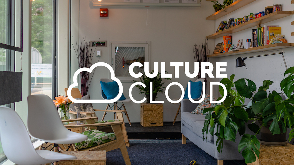Living room with chairs and a couch with the CultureCloud logo on top
