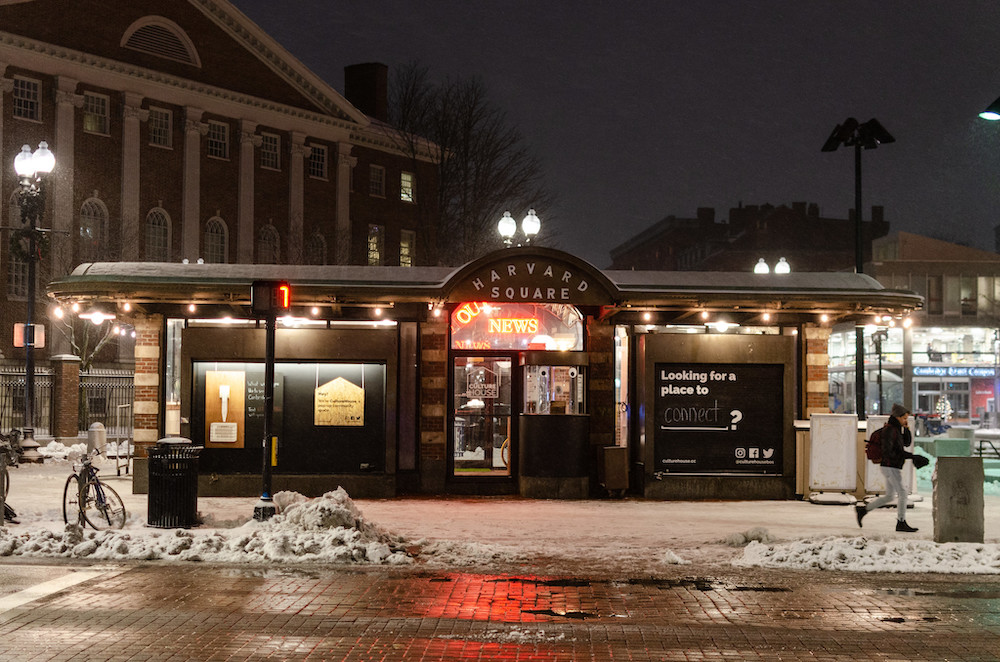 The former Out of Town News kiosk in Harvard Square at night