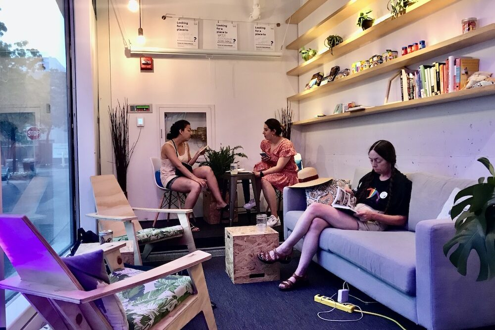 People sit on couches and chairs at the CultureHouse pop-up in Kendall Square